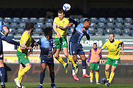 Norwich City defender (on loan from Burnley) Ben Gibson  (34)  battles for possession  with Wycombe Wanderers defender Jordan Obita (27) during the EFL Sky Bet Championship match between Wycombe Wanderers and Norwich City at Adams Park, High Wycombe, England on 28 February 2021.