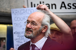 © Licensed to London News Pictures. 07/09/2020. LONDON, UK. Julian Assange's father, John Shipton, speaks to the media outside the Old Bailey as Wikileaks founder Julian Assange's  extradition hearing, which is expected to last for the next three or four weeks, resumes after it was postponed due to the coronavirus pandemic lockdown.  Julian Assange is wanted in the US for allegedly conspiring with army intelligence analyst Chelsea Manning to expose military secrets in 2010.  Photo credit: Stephen Chung/LNP