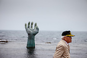 "Visitor at the ""Hand of Harmony"" located at Homigot Beach close to Pohang city at the South Korean East coast. South Korea"
