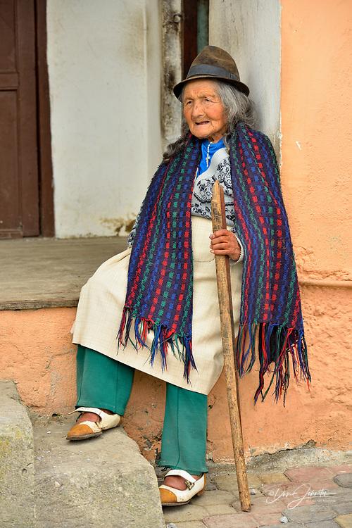 A senior citizen in Nono, relaxing on a street porch, Nono, Pichincha, Ecuador