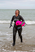 Award winning actress and Folkestone resident Jessica Hynes walks out of the sea after completing a 4 mile sea swim with 12 laps of Folkestone sunny sands bay to raise money for charity on the 7th of July 2020 in Folkestone, United Kingdom. She swam for two different charities, one being the Folkestone community hub, which has been supporting vulnerable people during the Covid-19 lockdown and the second called Green Kordofan which supports children in a refugee camp in Yida, South Sudan. Mrs Hynes is one of many volunteers who have worked at the hub, which provides help by delivering groceries, collecting prescriptions or just being a voice on the end of the phone.The second charity is Green Kordofan, which supports children in a refugee camp in Yida, South Sudan and was founded by Raga Gibreel, also from Folkestone.The registered charity is currently raising money for essential hygiene facilities such as washing and toilet blocks, to make the camp safe for the children who have been displaced by war.