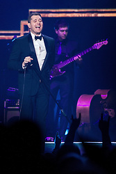 Michael Buble live. Saturday, 1st March 2014. Manchester , UK . Buble with an open button on his shirt , following a wardrobe malfunction . Michael Buble performs at the Phones 4 U Arena in Manchester . Picture by i-Images
