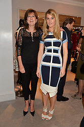 Left to right, the COUNTESS OF BALFOUR and her daughter LADY KINVARA BALFOUR at a party at Herve Leger, Lowndes Street, London on 12th November 2014 to view the latest collection.