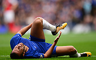 Pedro of Chelsea lies injured in pain. Premier league match, Chelsea v Arsenal at Stamford Bridge in London on Sunday 17th September 2017.<br /> pic by Andrew Orchard sports photography.