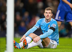 15.02.2014, Etihad Stadion, Manchester, ESP, FA Cup, Manchester City vs FC Chelsea, Achtelfinale, im Bild Manchester City's Edin Dzeko looks dejected after missing, chanced against Chelsea // during the English FA Cup Round of last 16 Match between Manchester City and FC Chelsea at the Etihad Stadion in Manchester, Great Britain on 2014/02/15. EXPA Pictures © 2014, PhotoCredit: EXPA/ Propagandaphoto/ David Rawcliffe<br /> <br /> *****ATTENTION - OUT of ENG, GBR*****