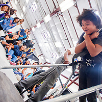091813       Cable Hoover<br /> <br /> Sixth-grader Wesley Frank takes a spin in a multi-axis simulator as his classmates watch in the NASA Traveling Space Museum at Navajo Technical University in Crownpoint Wednesday.