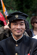 Portrait of a left wing wing student from Zengakuren, wearing a traditional high school uniform during a political rally at the open air stage in Hibiya Park, Tokyo, Japan. Sunday November 3rd  2013