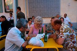 MALTA GOZO SANNAT JUL00 - Locals enjoy soft drinks and debate prior to the procession during the Sannat Fiesta.. . jre/Photo by Jiri Rezac. . © Jiri Rezac 2000. . Tel:   +44 (0) 7050 110 417. Email: info@jirirezac.com. Web:   www.jirirezac.com
