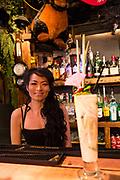 Elmurst, Queens, NY - December 16, 2016. Pata Paplean's bartender Por and a Tom Yum cocktail.