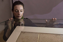 "The last letter of Mary Queen of Scots written just six hours before her execution is on public display at the National Library of Scotland on the 430th anniversary of her death.<br /> <br /> The letter was written at 2am on 8 February 1857 as Mary prepared to meet her death at Fotheringay Castle. Writing to Henri III, King of France, the brother of her first husband, she says ""I am to be executed like a criminal at eight in the morning"".<br /> <br /> The letter is pictured with Ciara McDermott, Exhibitions Office at the NLS."