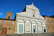 The Romanesque marble facade & mosaic begun in about 1090 of San Miniato al Monte (St. Minias on the Mountain) basilica , Florence, Italy. .<br /> <br /> Visit our ITALY PHOTO COLLECTION for more   photos of Italy to download or buy as prints https://funkystock.photoshelter.com/gallery-collection/2b-Pictures-Images-of-Italy-Photos-of-Italian-Historic-Landmark-Sites/C0000qxA2zGFjd_k<br /> If you prefer to buy from our ALAMY PHOTO LIBRARY  Collection visit : https://www.alamy.com/portfolio/paul-williams-funkystock/florence.html ..<br /> <br /> Visit our MEDIEVAL PHOTO COLLECTIONS for more   photos  to download or buy as prints https://funkystock.photoshelter.com/gallery-collection/Medieval-Middle-Ages-Historic-Places-Arcaeological-Sites-Pictures-Images-of/C0000B5ZA54_WD0s
