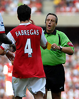 Photo: Ed Godden.<br />Arsenal v Sheffield United. The Barclays Premiership. 23/09/2006. Referee A. Wiley shows Arsenals's Cesc Fabregas the yellow card.