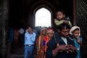 Visitors are entering the main complex of the Taj Mahal, in Agra.