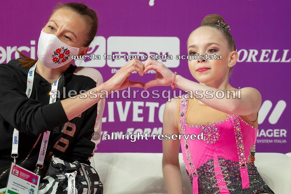 Stliana Nikolova sitting at the Kiss and Cry of the Rhythmic Gymnastics World Cup in Pesaro.