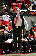 Utah head coach Jim Boylen jumps as he yells out instructions to his team during an NCAA college basketball game, Wednesday, Jan. 19, 2011, in Salt Lake City. (AP Photo/Colin E Braley)