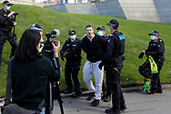 MELBOURNE, VIC - SEPTEMBER 05: Police arrest a man during the Anti-Lockdown Protest on September 05, 2020 in Sydney, Australia. Stage 4 restrictions are in place from 6pm on Sunday 2 August for metropolitan Melbourne. This includes a curfew from 8pm to 5am every evening. During this time people are only allowed to leave their house for work, and essential health, care or safety reasons. (Photo by Dave Hewison/Speed Media)