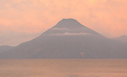Volcan San Pedro 3020m in the early morning across Lake Atitlan from Panajachel.  Panajachel, Republic of Guatemala. 04Mar14.
