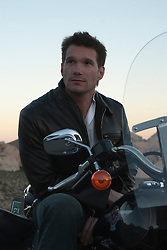 man sitting on a motorcycle