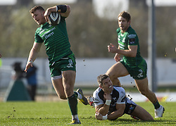March 2, 2019 - Galway, Ireland - Peter Robb of Connacht runs with the ball and James Hook of Ospreys during the Guinness PRO 14 match  between Connacht Rugby and Ospreys at the Sportsground in Galway, Ireland on March 2, 2019  (Credit Image: © Andrew Surma/NurPhoto via ZUMA Press)
