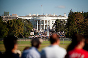 Spectators watch from the Ellipse as Pope Francis addresses a ceremony at the White House in Washington, District of Columbia, U.S., on Wednesday, Sept. 23, 2015.  Photographer: Pete Marovich/Bloomberg