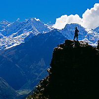 A trekker on an Inca trail views Nevado Sacsayrayoc in the Cordillera Vilcabamba