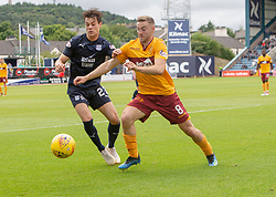 Dundee's James Vincent and Motherwell's Danny Johnson. Dundee 1 v 3 Motherwell, SPFL Ladbrokes Premiership game played 1/9/2018 at Dundee's Kilmac stadium Dens Park