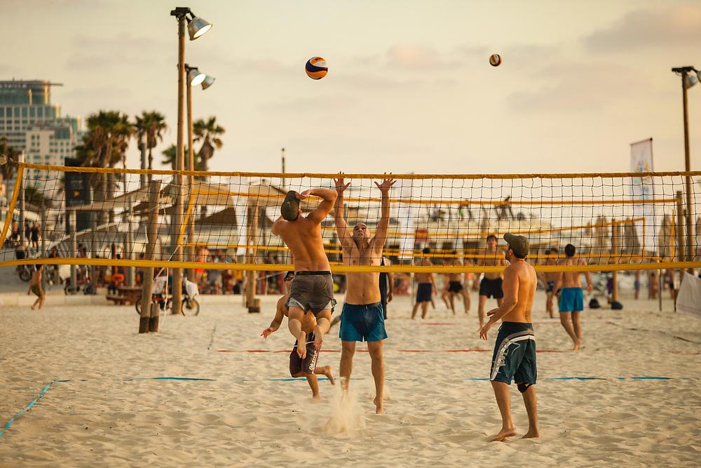People play beach volleyball on Gordon Beach in Tel Aviv's Merkaz Hair neighborhood