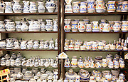 Display of pottery inside Santa Ana ceramic tile shop in Triana, Seville, Spain