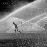 Players return to the field for the second half with the sprinklers still working during the New York City FC Vs New England Revolution, MSL regular season football match at Yankee Stadium, The Bronx, New York,  USA. 26th March 2016. Photo Tim Clayton