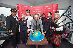 Alan Cumming, with staff and piper Louise Marshall, with the cake, as Delta launching year-round nonstop service from Edinburgh to New York-JFK today at Edinburgh Airport.