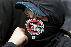 © Licensed to London News Pictures . 20/06/2015 . London , UK . A woman wearing a face covering . Tens of thousands of people march from the Bank of England to Parliament , to protest economic austerity in Britain . Photo credit: Joel Goodman/LNP