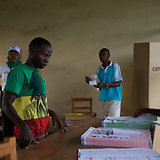 A voter at the ballot table in a polling station in Kinama neighbourhood in Bujumbura, to vote in the country's parliamentary elections, on June 29, 2015.