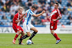 Conor Coady of Huddersfield is challenged by Adam Clayton of Middlesbrough - Photo mandatory by-line: Rogan Thomson/JMP - 07966 386802 - 13/09/2014 - SPORT - FOOTBALL - Huddersfield, England - The John Smith's Stadium - Huddersfield town v Middlesbrough - Sky Bet Championship.
