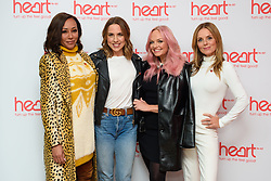 Spice Girls (left to right) Melanie Brown, Melanie Chisholm, Emma Bunton and Geri Horner at a live appearance this morning on the Heart Breakfast show with host Jamie Theakston at Global Radio in Leicester Square, London.