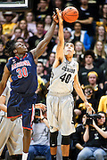 SHOT 2/14/13 9:57:38 PM - Colorado's Josh Scott #40 tips a rebound to a teammate in front of Arizona's Angelo Chol #30 during their regular season Pac-12 basketball game at the Coors Event Center on the Colorado campus in Boulder, Co. Colorado won the game 71-58. (Photo by Marc Piscotty / © 2013)