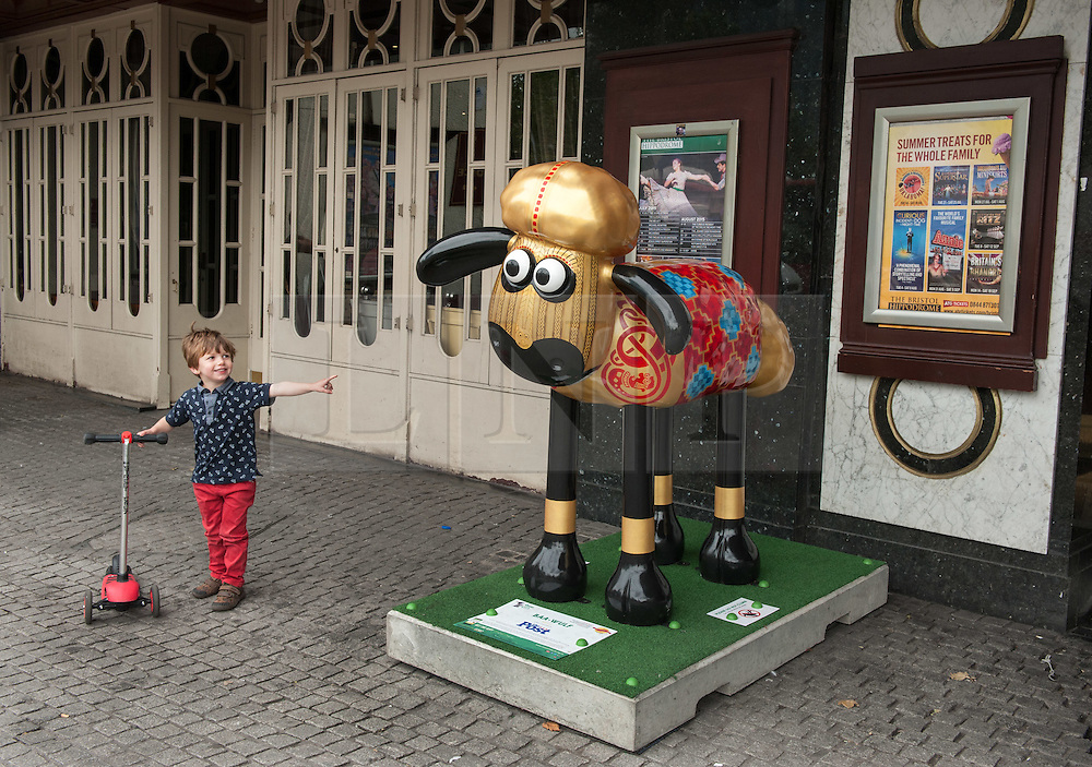 © Licensed to London News Pictures. 06/07/2015. Bristol, UK.  SHAUN THE SHEEP, 'Baa-Wulf' designed by Peter Lord.  The Shaun in the City trail starts today with 70 5ft tall Shaun the Sheep sculptures originally devised by Aardman Animations with these sculptures decorated by various artists.  The Shaun trail happened in London in the spring, and the Bristol Trail lasts till 31 August.  At the end of September all 120 Shaun sculptures will be viewable together in Covent Garden.  All sculptures will then go to auction on 8th October, with proceeds from the Bristol sculptures benefitting The Grand Appeal which funds pioneering medical equipment, facilities, and comforts for patients at Bristol Children's Hospital. Proceeds from the London sculptures will benefit Wallace & Gromit's Children's Charity supporting children's hospitals and hospices throughout the UK. Photo credit : Simon Chapman/LNP