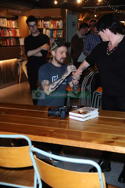"""March 22, 2019 - London, United Kingdom - Frank Turner signs copies of his book """"Try This At Home"""" at Waterstones Tottenham Court Road in London. (Credit Image: © Terry Scott/SOPA Images via ZUMA Wire)"""