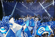 Brighton team celebrate on the stage during the Brighton & Hove Albion Football Club Promotion Parade at Brighton Seafront, Brighton, United Kingdom on 14 May 2017. Photo by Phil Duncan.
