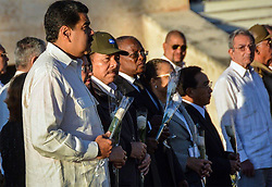 December 4, 2016 - Santiago, CUBA - Venezuela's President Nicolas Maduro, left, and Nicaragua's President Daniel Ortega attend the burial ceremony of the ashes of the late Fidel Castro at the Santa Ifigenia cemetery in Santiago, Cuba, Sunday December 4, 2016. (Credit Image: © Prensa Internacional via ZUMA Wire)