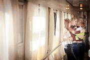 Passengers outside their cabin on-board the BAM (Baikal-Amur Mainline) Railway Line. Siberia, Russia