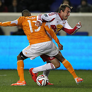 Eric Alexander, New York Red Bulls, is tackled by Ricardo Clark, (left), Houston Dynamo, during the New York Red Bulls V Houston Dynamo, Major League Soccer regular season match at Red Bull Arena, Harrison, New Jersey. USA. 23rd April 2014. Photo Tim Clayton