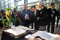 The Prince of Wales (second left) and Colombian President Juan Manuel Santos (third left) are shown a collection of natural history books in the Darwin Centre at the Natural History Museum in London.