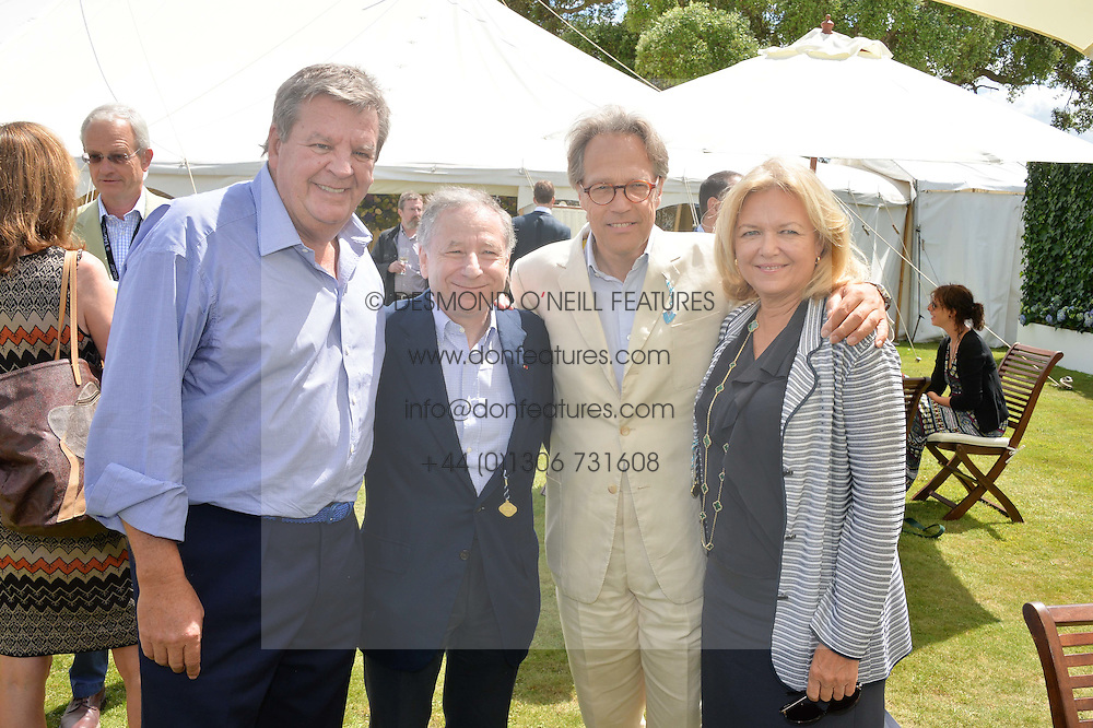Left to right, JOHANN RUPERT he is Chief Executive of Richemont, JEAN TODT, the EARL OF MARCH and MRS JOHANN RUPERT at the Cartier hosted Style et Lux at The Goodwood Festival of Speed at Goodwood House, West Sussex on 29th June 2014.