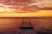 Dock on Lake of teh Woods at sunrise<br />