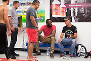 """UFC light heavyweight Jon Jones and UFC welterweight Donald """"Cowboy"""" Cerrone chat with coaches after training at Jackson Wink MMA in Albuquerque, New Mexico on June 9, 2016."""