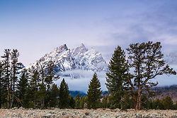 """The Cathedral Group of peaks with a new frosting of autumn snow in Grand Teton National Park at sunrise.<br /> <br /> For production prints or stock photos click the Purchase Print/License Photo Button in upper Right; for Fine Art """"Custom Prints"""" contact Daryl - 208-709-3250 or dh@greater-yellowstone.com"""