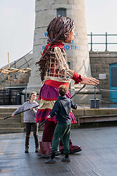 © Licensed to London News Pictures. 19/10/2021. FOLKESTONE, UK. A 3.5m tall puppet of a 9 year old Syrian girl called Little Amal, who's travelled 8,000km through Europe from Turkey, arrives today in the UK at Folkestone before travelling onwards to various venues in London including a 10th birthday party at the V&A. Photo credit: Stuart Brock/LNP