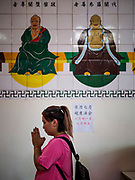 25 AUGUST 2018 - GEORGE TOWN, PENANG, MALAYSIA: People pray in Kuan Yin Temple on Ghost Day, the full moon day (or night) that falls in the middle of Hungry Ghost month. The Ghost Festival, also known as the Hungry Ghost Festival is a traditional Taoist and Buddhist festival held in Chinese communities throughout Asia. Ghost Day, is on the 15th night of the seventh month (25 August in 2018). During Ghost Festival, the deceased are believed to visit the living. In many Chinese communities, there are Chinese operas and puppet shows and elaborate banquets are staged to appease the ghosts.       PHOTO BY JACK KURTZ
