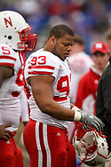 Ndamukong Suh stands on the sideline during Nebraska's 31-17 win in Lawrence, Kan. on Nov. 14, 2009. © Aaron Babcock