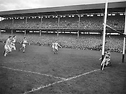 Dublin hits the ball into the back of the Derry goal during the All Ireland Senior Gaelic Football final Dublin vs Derry in Croke Park on 28th September 1958. Dublin 2-12 Derry 1-9.